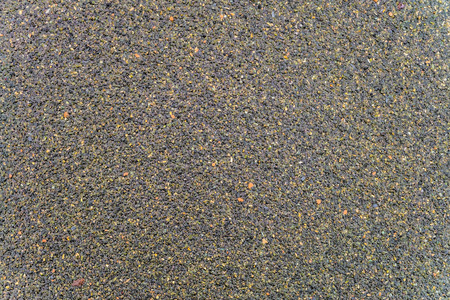 Textureof wet surface of the coating of bitumen roll roofing waterproofing with the sprinkling of stone chips. Roofing background close-up. Reklamní fotografie