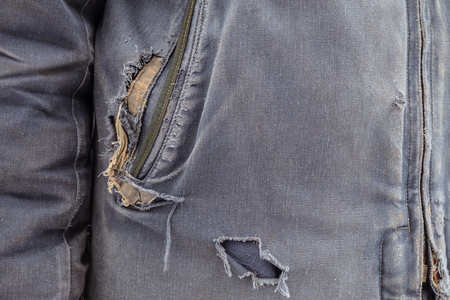 Torn outerwear. Ragged blue clothes. 版權商用圖片