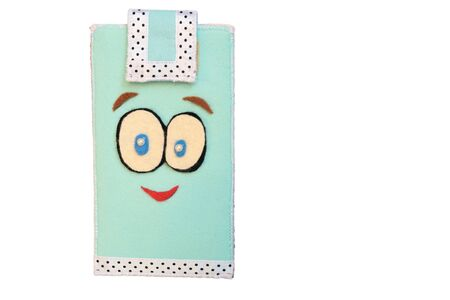 Handmade phone case made of felt. Fictional character - face with big eyes and smile.