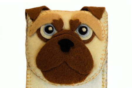 Handmade phone case made of felt with dog face. Fictional character close-up.