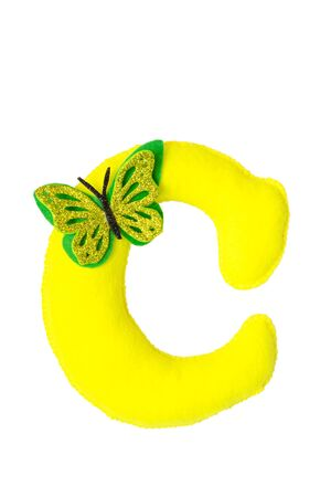 Handmade yellow letter C made of felt. Childrens alphabet C with small butterfly.