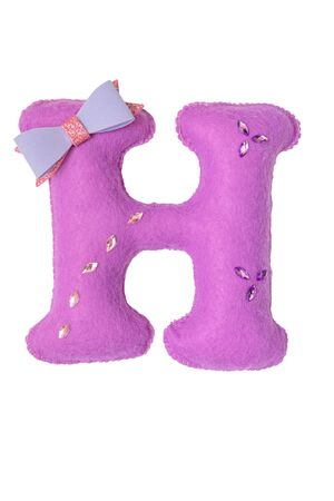 Handmade purple letter H made of felt. Childrens alphabet H with small bow-tie and brooches.