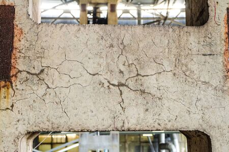 Mesh of wet cracks on the surface two-branch column in industrial building