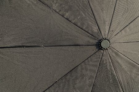 Black waterproof fabric. Top view. Pongee umbrella fabric. Фото со стока