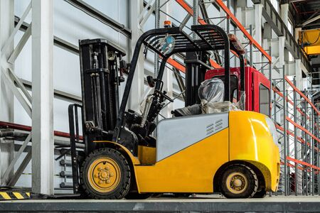 Compact forklift truck in a industrial warehouse building