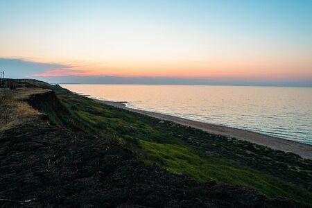 Evening sea sunset. Azov sea horizon. Steep slope coast. Reklamní fotografie