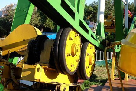 Close-up of ferris wheel drive mechanism. Gear wheel with chain drive at the amusement park.