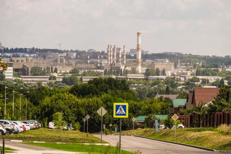 Belgorod, Russia - July 29, 2019: View of a cement plant from the Novaya Zhizn (New Life) district. Western industrial area.