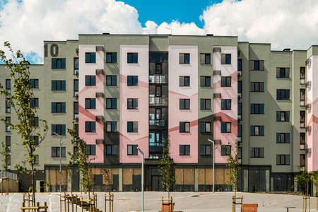 Belgorod, Russia - July 29, 2019: Facade residential typical building under a blue cloudy sky. Southwestern residential area of Belgorod, Russia. Novaya Zhizn (New Life) city district.