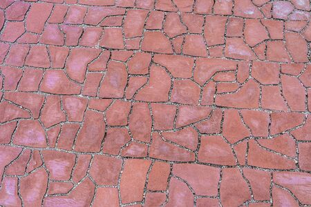 Outdoors red pavement covering large area. Footpath paved with tiled stone. Foto de archivo
