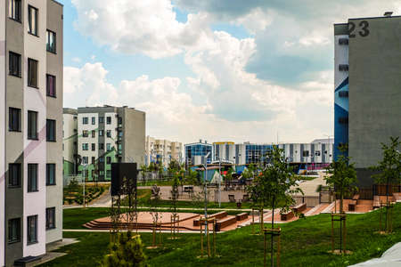 Belgorod, Russia - July 29, 2019: Southwestern residential area of Novaya Zhizn (New Life) city district. New residential neighbourhood with typical simple buildings. Affordable housing. Outdoors cinema and primary school. Editorial