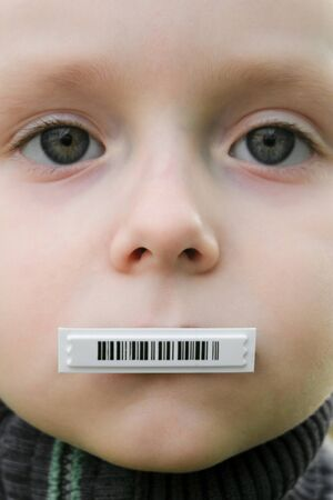 Child face with barcode on mouth. Individual identifier concept. Barcode in this image is not related to the designation of the real product (produced in a graphical editor).