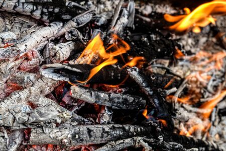 Fire. Burning charcoal in the grill.