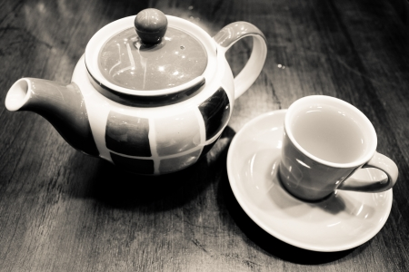 set of tea pot and tea cup has taken in monochrome  photo