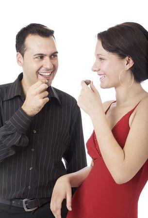 Happy couple 2, eating chocolates for Valentine photo
