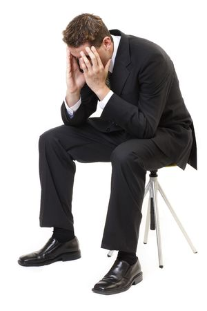 slump: Depressed businessman sitting face in hands