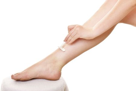 Lady shaving legs close up, 1 photo
