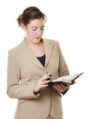 organise: Businesswoman joven que escribe una cita en su diario