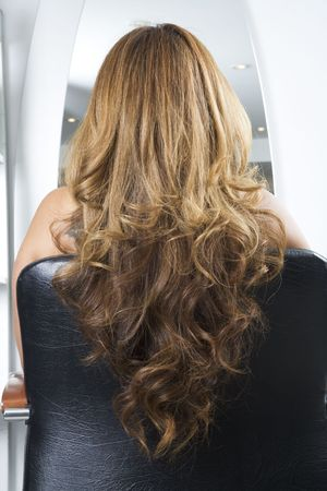 frizz: Long curls on the back of a chair
