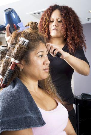 Hair dresser applying rollers 3 photo