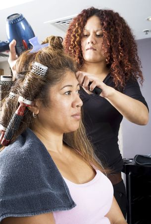 asian afro: Hair dresser applying rollers 3 Stock Photo