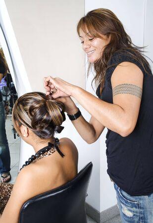 Hair dresser making an intricate hair do 2 photo