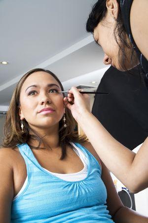 eye liner: Make up artist applying eye liner
