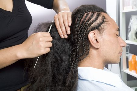 frizz: Hair stylist making afro plates on male