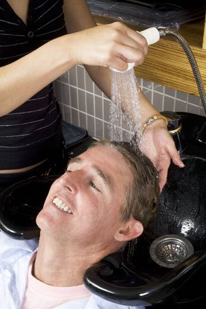 untitled key: Hair desser washing a mans hair at the salon 2
