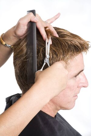 untitled key: Hair dresser cutting a mans hair short