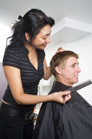 untitled key: Man having his hair styled at the hair dressing salon Stock Photo