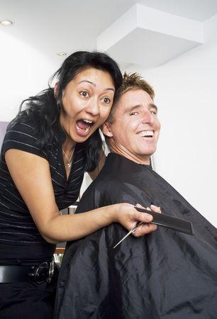 Hair dresser and client having fun at the salon photo