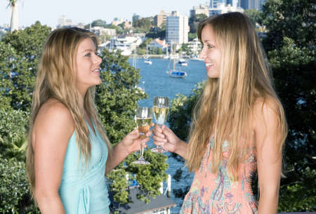 Girlfriends drinking champagne on the balcony photo