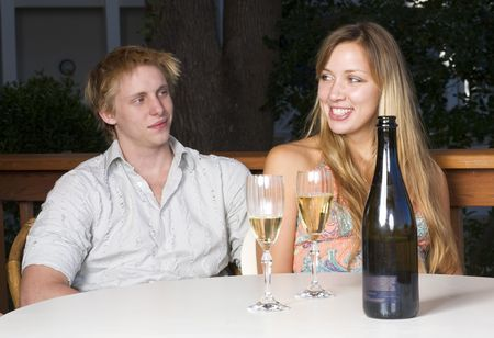 Young couple drinking champagne on the balcony photo