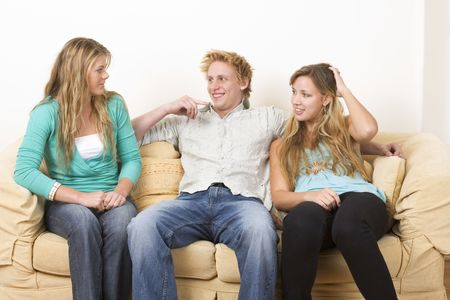 sister: Three friends sitting on a couch 1 Stock Photo