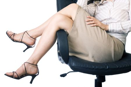 Businesswomans legs over the chair photo