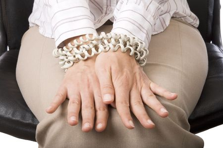 chord: Businesswomans hands tied by telephone chord Stock Photo