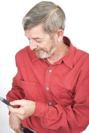 Senior calling on a mobile phone photo