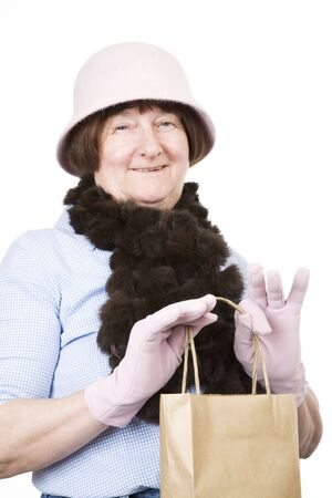 pink hat: Senior lady shopping, with pink hat and gloves Stock Photo