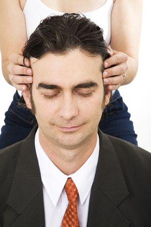 Lady giving businessman a head massage photo