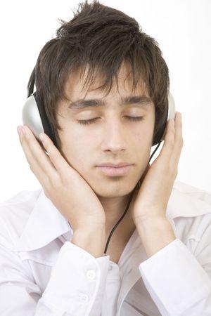 fanatic studio: Teenager listening to music with large headphones Stock Photo