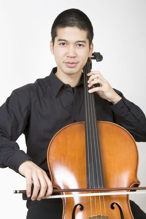 virtuoso: Asian cellist bowing 1 Stock Photo
