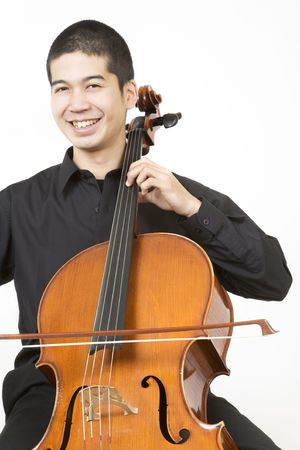 virtuoso: Asian cellist bowing 2 Stock Photo