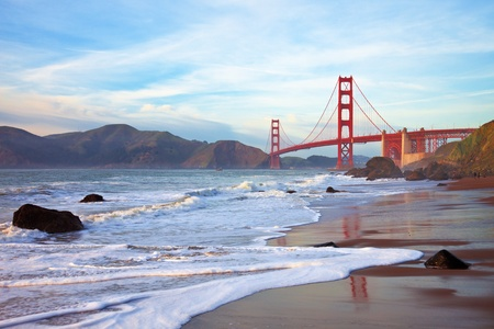 bay area: Golden Gate bridge at sunset seen from Marshall Beach, San Francisco. Stock Photo