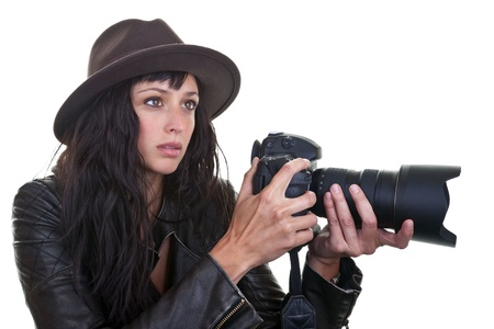 photojournalist: Attractive young woman taking photos with a large DSLR