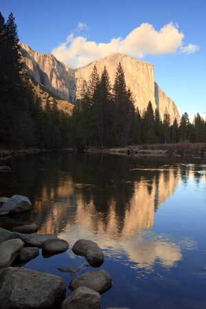 el capitan: El Capitan at sunset, reflected in the Merced River, Yosemite National Park. Stock Photo
