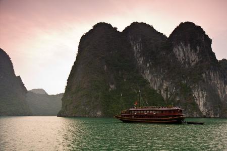 ha: Boat anchored in Ha Long Bay, Vietnam. Stock Photo
