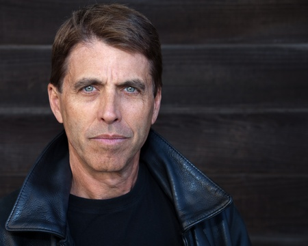 Handsome middle aged man in a leather jacket. Stock Photo