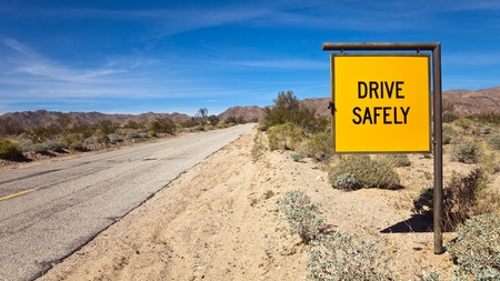 drive safely: Drive Safely road sign at the south entrance to Joshua Tree National Park, California. Stock Photo