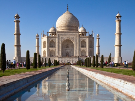 Classic view of Taj Mahal with reflections in a pond in Agra, India